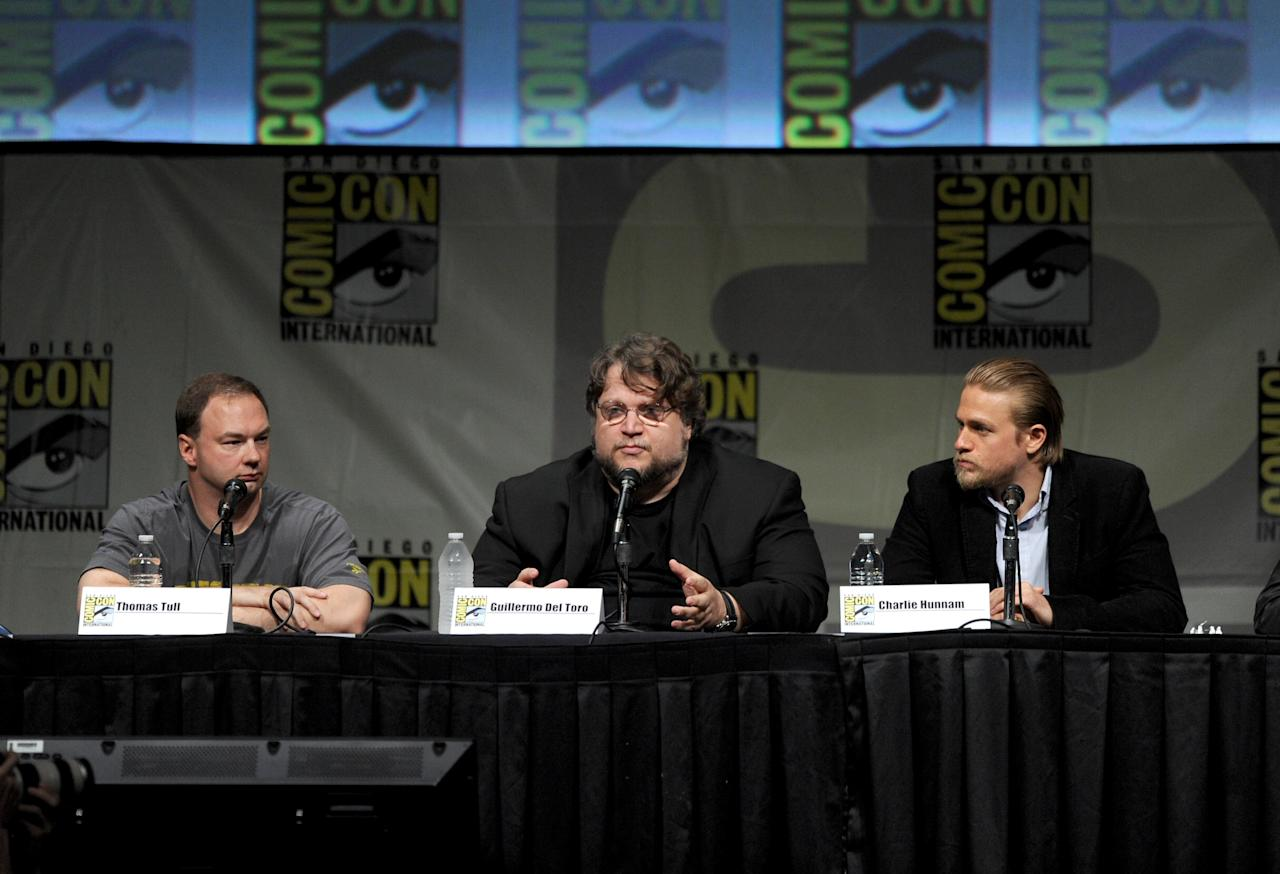 "SAN DIEGO, CA - JULY 14:  Producer Thomas Tull, director Guillermo del Toro, and actor Charlie Hunnam speak at Warner Bros. Pictures and Legendary Pictures Preview of ""Pacific Rim"" during Comic-Con International 2012 at San Diego Convention Center on July 14, 2012 in San Diego, California.  (Photo by Kevin Winter/Getty Images)"