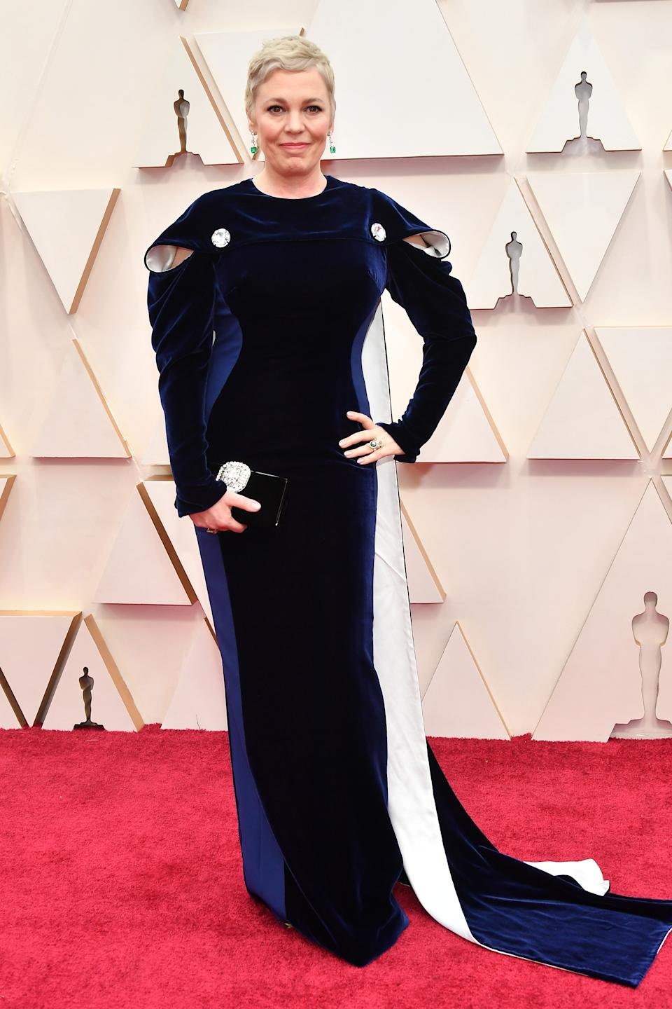 Last year's Best Actress winner kept warm in a sleeved Stella McCartney gown with structured shoulder detailing.