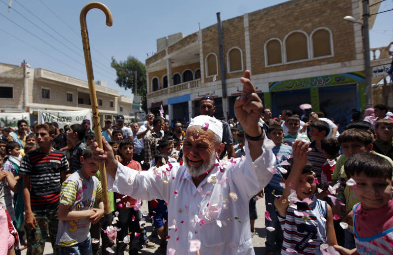 An elderly Syrian man attends an anti-Bashar Assad protest after Friday prayers on the outskirts of Idlib, Syria, Friday, June 8, 2012. (AP Photo)