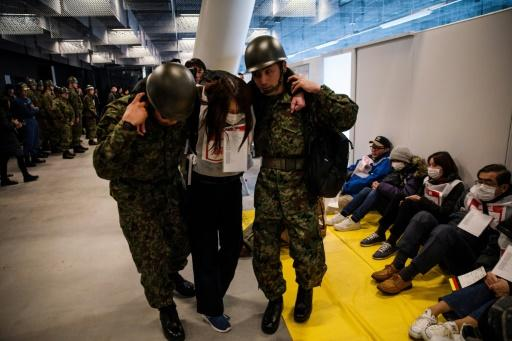 Soldiers help the 'wounded' at an earthquake simulation