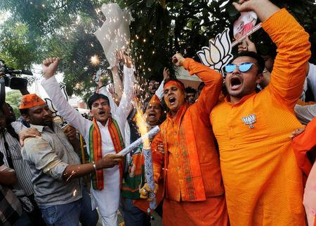 BJP supporters celebrate after learning the initial election results outside the party headquarters in New Delhi, India, May 23, 2019. REUTERS/Adnan Abidi