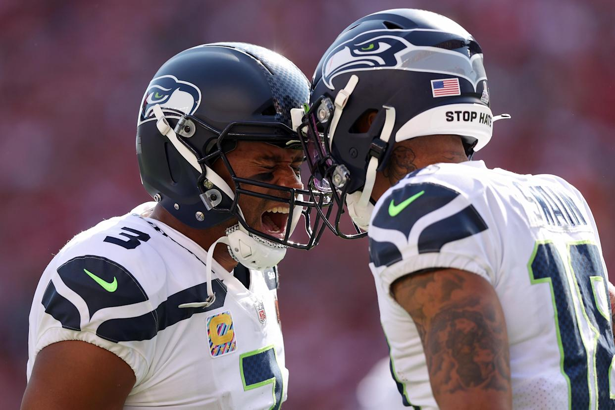 Freddie Swain (18) of the Seattle Seahawks celebrates a touchdown with Russell Wilson. (Photo by Ezra Shaw/Getty Images)