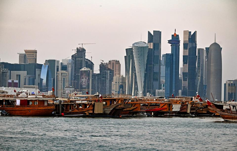 A view of boats moored in front of high-rise buildings in the Qatari capital, Doha.