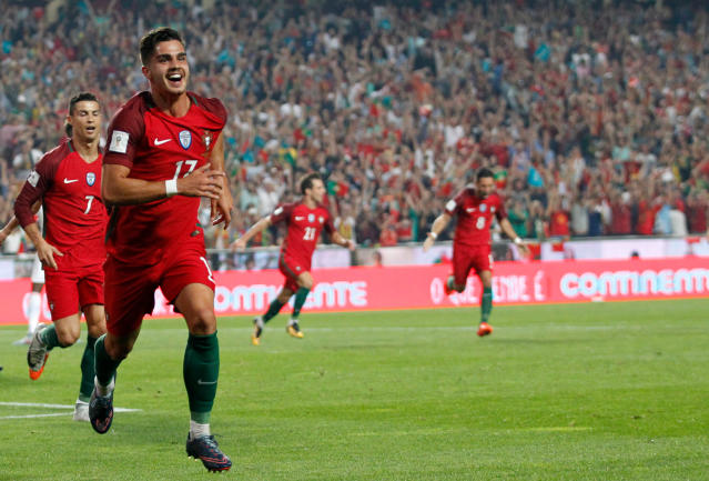 FILE - In this Tuesday, Oct. 10, 2017 file photo, Portugal's Andre Silva celebrates after scoring goal during the World Cup Group B qualifying soccer match between Portugal and Switzerland at the Luz stadium in Lisbon. (AP Photo/Armando Franca, File)