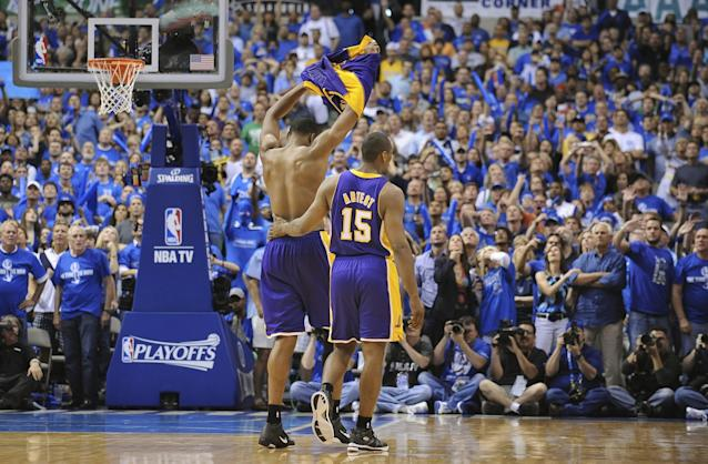 """Lakers center Andrew Bynum takes off his jersey after being ejected as Ron Artest walks next to him during Game 4 of the 2011 Western Conference semifinals against the Dallas Mavericks. <span class=""""copyright"""">(Wally Skalij / Los Angeles Times)</span>"""