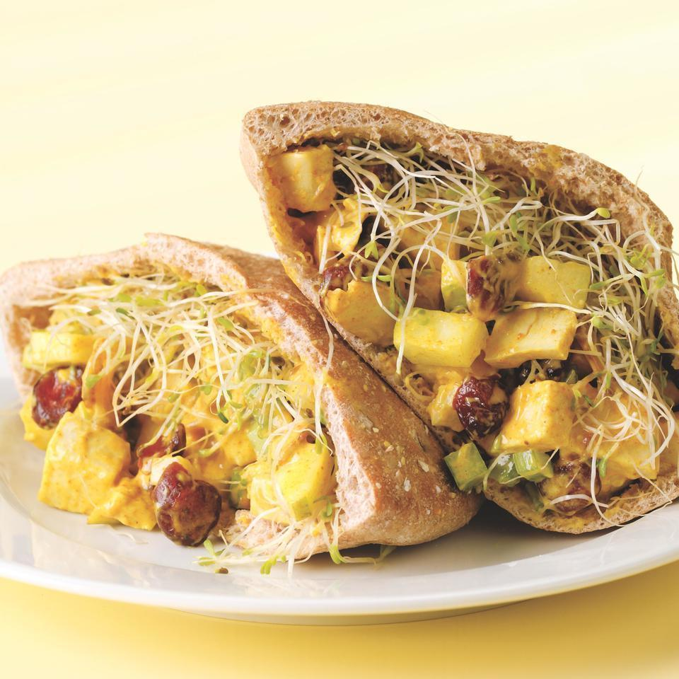 <p>Cranberries and pear are sweet counterpoints in this tangy curried chicken salad. Toasted sliced almonds add a nutty crunch.</p>