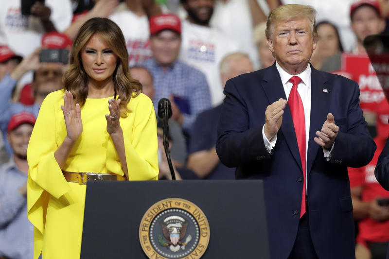First lady Melania Trump and President Donald Trump greet supporters at a rally to formally announce his 2020 re-election bid Tuesday, June 18, 2019, in Orlando, Fla. (AP Photo/John Raoux)