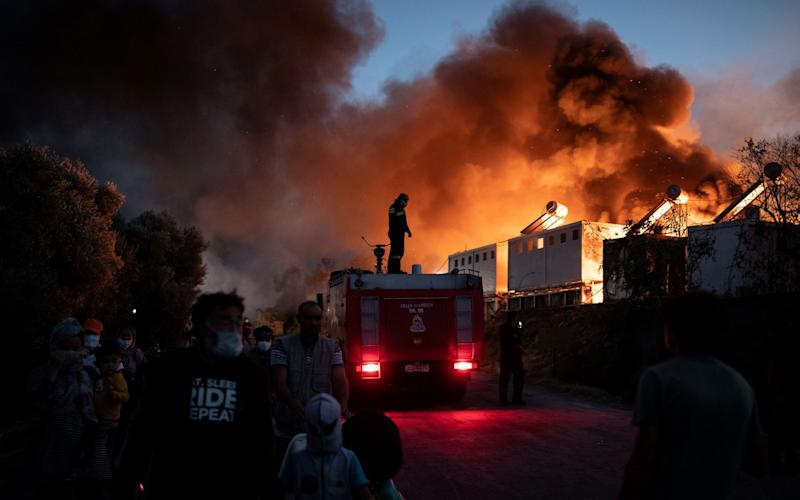 Huge fires, fanned by strong winds, have razed the camp to the ground - Reuters