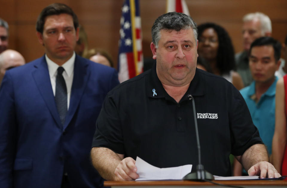 FILE - In this Feb. 13, 2019, file photo, Tony Montalto, father of Gina Montalto, who was killed during the Parkland school shooting, speaks as Florida Gov. Ron DeSantis, left, looks on during a news conference in Fort Lauderdale, Fla. It's been more than 1,000 days since a gunman burst into the Florida high school, killed 17 people and wounded 17 others, but Nikolas Cruz's death penalty trial is in limbo. Parents of those slain and wounded are divided over the death penalty, said Montalto. (AP Photo/Wilfredo Lee, File)