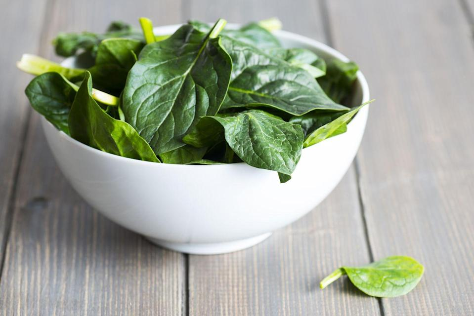 """<p>Leafy green vegetables, like spinach, kale, and Swiss chard, are chock-full of <a href=""""https://www.prevention.com/food-nutrition/a23012367/folate-deficiency-symptoms/"""" rel=""""nofollow noopener"""" target=""""_blank"""" data-ylk=""""slk:folate"""" class=""""link rapid-noclick-resp"""">folate</a>, which is vital for cell growth and red blood cell formation. They also back carotenes (pigments that act as antioxidants) that help maintain healthy vision, bones, teeth, and <a href=""""https://www.prevention.com/beauty/skin-care/g23740428/best-anti-aging-foods/"""" rel=""""nofollow noopener"""" target=""""_blank"""" data-ylk=""""slk:skin"""" class=""""link rapid-noclick-resp"""">skin</a>.</p><p>""""Folate from natural food sources helps protect brain function as we age,"""" Dixon says. On the other hand, """"carotenes bring a boost of antioxidants, which protect against DNA decay or the breakdown of cells,"""" she adds. """"This damage can accumulate over time, contributing to cancer and heart disease."""" </p><p>Just be sure to stick with whole foods to get your fill of folate, instead of supplements. Taking folic acid supplements can increase your risk of certain cancers, notably <a href=""""https://www.prevention.com/health/health-conditions/a19872320/colon-cancer-symptoms/"""" rel=""""nofollow noopener"""" target=""""_blank"""" data-ylk=""""slk:colon cancer"""" class=""""link rapid-noclick-resp"""">colon cancer</a>, Dixon says. <br></p>"""
