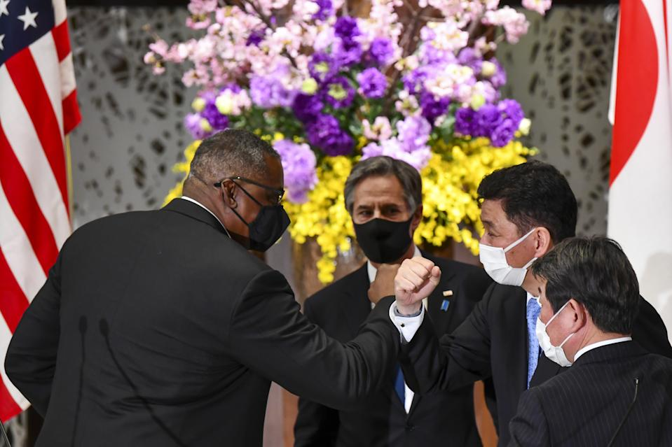 TOKYO, JAPAN - MARCH 16 : US Defense Secretary Lloyd Austin (L) and Secretary of State Antony Blinken (2nd L) leave after their joint press conference with Japan's Foreign Minister Toshimitsu Motegi (R) and Defence Minister Nobuo Kishi (2nd R) after their 2+2 meeting at Iikura Guest House in Tokyo on March 16, 2021. (Photo by AFP/KAZUHIRO NOGI/Pool/Anadolu Agency via Getty Images)
