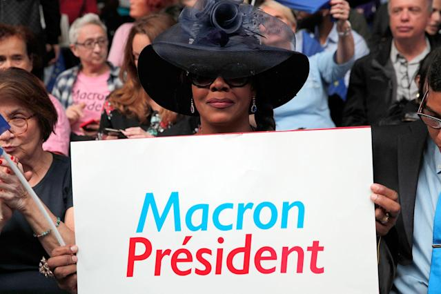 <p>A supporter of independent centrist presidential candidate Emmanuel Macron holds up a poster during a campaign rally in Paris, France, Monday, May 1st, 2017. With just six days until a French presidential vote that could define Europe's future, far-right leader Marine Le Pen and centrist Emmanuel Macron are holding high-stakes rallies Monday. (AP Photo/Christophe Ena) </p>