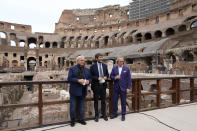 From left, Tod's Diego Della Valle, Italian Culture Minister Dario Franceschini and Tod' Andrea Della Valle pose for the media prior to the start of a press conference at the Colosseum, in Rome, Friday, June 25, 2021. Italy's culture minister on Friday formally announced the completion of work to shore-up and restore the underground section, in the presence of the founder of Tod's, the shoe-and-luxury-goods maker, who has footed the bill. AP Photo/Andrew Medichini)