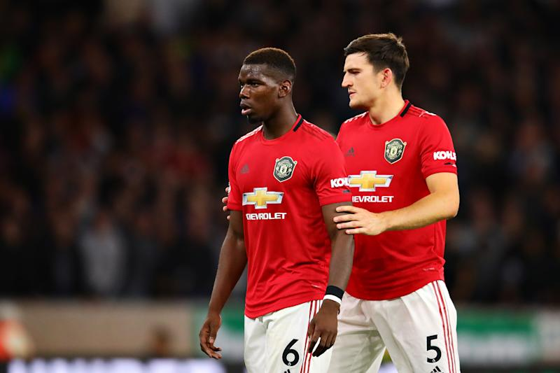 WOLVERHAMPTON, ENGLAND - AUGUST 19: Paul Pogba of Manchester United talks with teammate Harry Maguire during the Premier League match between Wolverhampton Wanderers and Manchester United at Molineux on August 19, 2019 in Wolverhampton, United Kingdom. (Photo by Chris Brunskill/Fantasista/Getty Images)