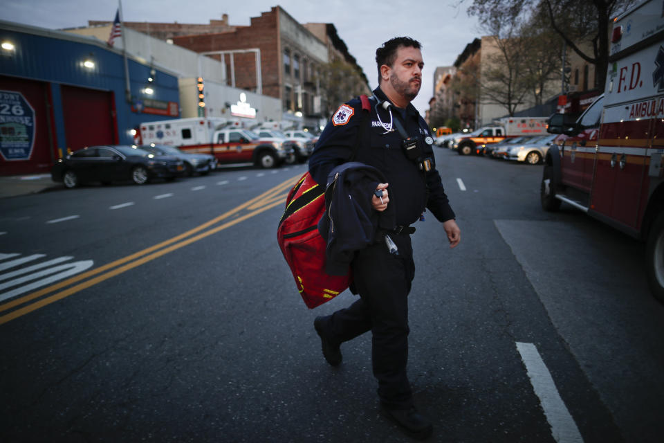 """In this April 23, 2020, photo FDNY paramedic Alex Tull, who has recently recovered from COVID-19, prepares to begin his shift outside EMS station 26, the """"Tinhouse"""", in the Bronx borough of New York. (AP Photo/John Minchillo)"""