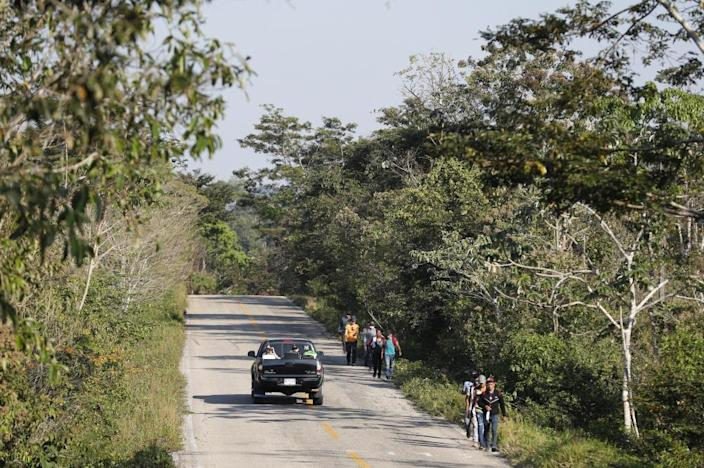 Migrants trek on the highway from Frontera Corozal to Palenque in Chiapas state