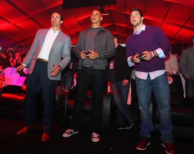 Brees, his New Orleans Saints teammate Jimmy Graham, and Tebow were on their feet during the video game showdown.
