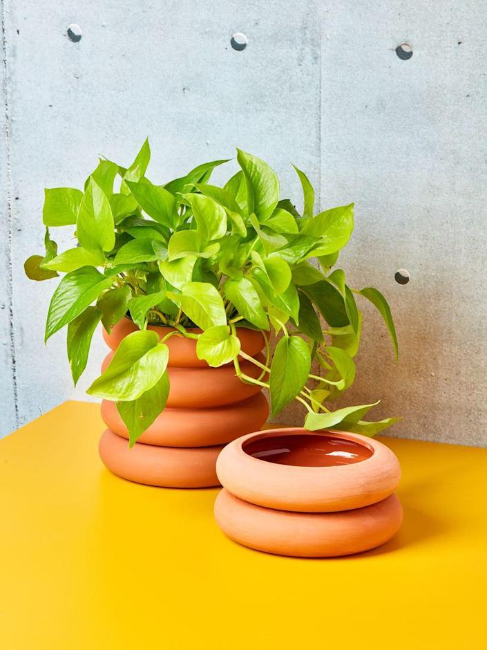 """Tall or short, terra-cotta or matte white, these Chen and Kai planters feature drainage holes and a built-in saucer. $78, Coming Soon. <a href=""""https://comingsoonnewyork.com/products/short-and-tall-planter"""" rel=""""nofollow noopener"""" target=""""_blank"""" data-ylk=""""slk:Get it now!"""" class=""""link rapid-noclick-resp"""">Get it now!</a>"""