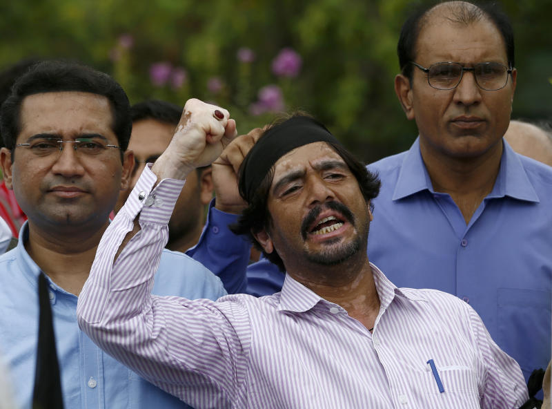 A journalist shouts slogans during a demonstration to denounce rampant censorship in Islamabad, Pakistan, Tuesday, July 16, 2019. Pakistani journalists are holding nationwide protests to denounce rampant censorship by the country's powerful security services, massive layoffs due to budget cuts and months-long delays in payments of their wages. (AP Photo/Anjum Naveed)