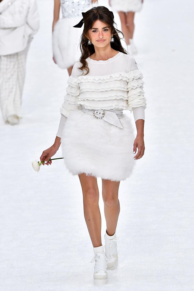 Penélope Cruz paid her respects to the late Karl Lagerfeld from the runway, which she walked for the first time in honor of the late designer's final Chanel show, just two weeks after his death.