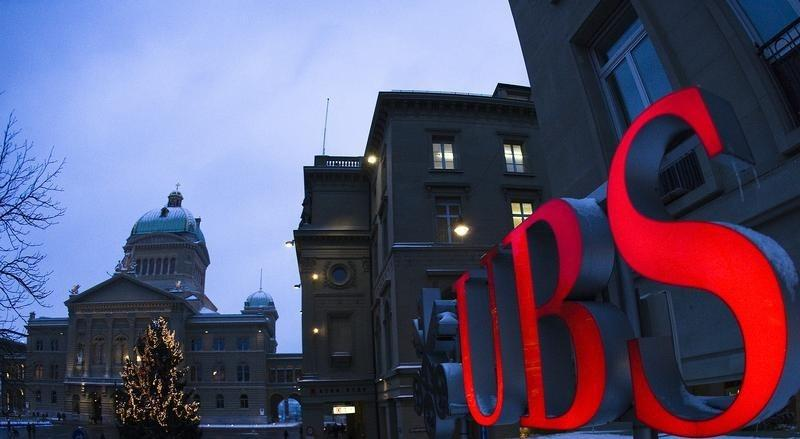 The logo of Swiss bank UBS is pictured in front of the Swiss Federal Palace in Bern