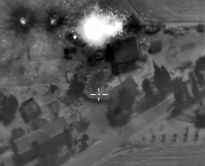 "A video grab made on October 1, 2015 shows an image from footage made available on the Russian Defence Ministry's official website, purporting to show an airstrike in Syria"" (AFP Photo/)"