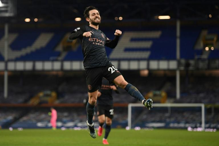 Leaping clear: Bernardo Silva scored Manchester City's third goal as they moved 10 points clear at the top of the Premier League