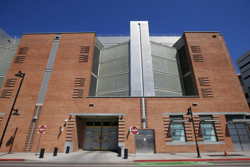 FILE - This March 21, 2020, file photo, shows the Maricopa County 4th Avenue Jail in downtown Phoenix. The number of inmates in Arizona's prisons and in some county jails in the state have decreased since the start of pandemic. The decrease reflects a slowdown in the state's court system that has held far fewer criminal jury trials over the last year as it took steps to prevent the coronavirus from spreading at courthouses. (AP Photo/Ross D. Franklin, File)
