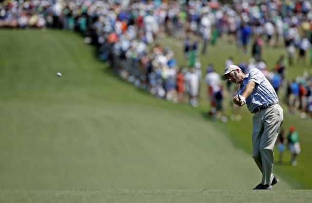 Jim Furyk hits off the first fairway during the third round of the Masters golf tournament Saturday, April 12, 2014, in Augusta, Ga. (AP Photo/Matt Slocum)