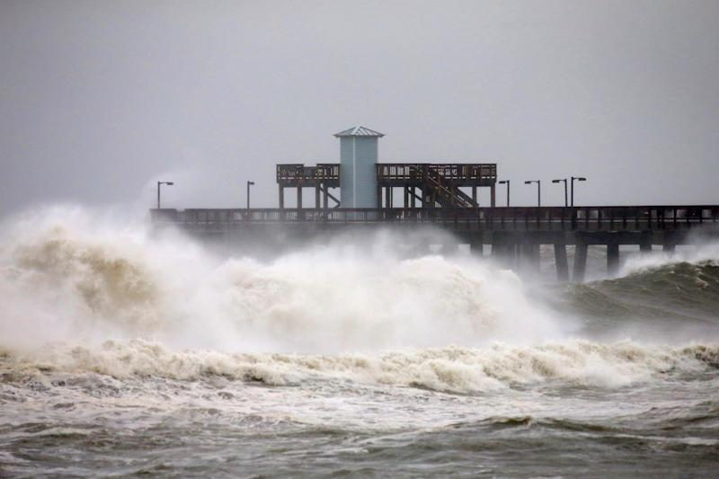 Waves crash along a pier as Hurricane Sally approaches in Gulf Shores, Alabama, U.S., September 15, 2020. REUTERS/Jonathan Bachman