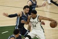 Milwaukee Bucks' Giannis Antetokounmpo tries to get by Memphis Grizzlies' Dillon Brooks during the first half of an NBA basketball game Saturday, April 17, 2021, in Milwaukee. (AP Photo/Morry Gash)