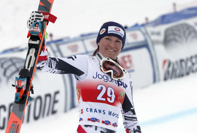 Austria's Andrea Fischbacher celebrates at the finish area after winning an alpine ski, World Cup women's downhill, in Crans Montana, Switzerland, Sunday, March 2, 2014. (AP Photo/Marco Trovati)