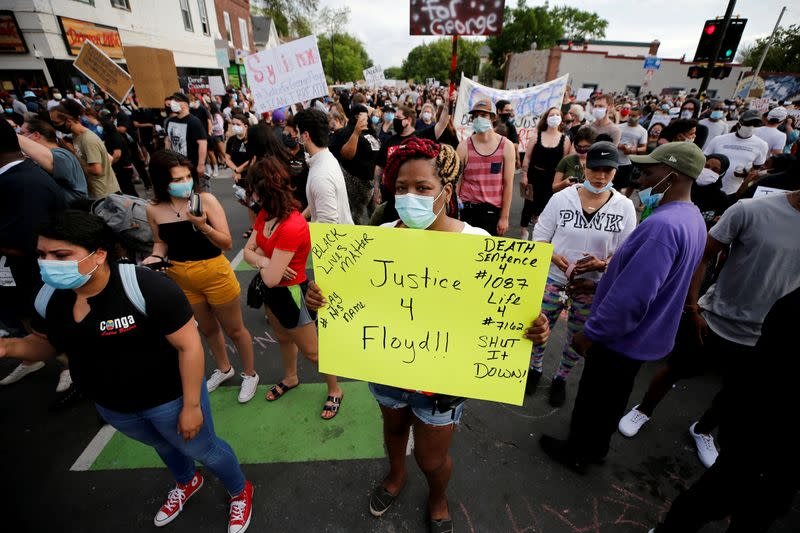 FILE PHOTO: Protesters gather at the scene where Floyd was pinned down by a police officer in Minneapolis