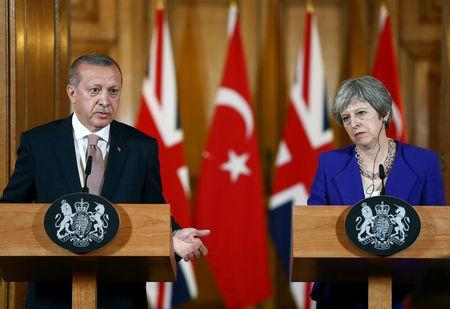 Turkish President Tayyip Erdogan and Britain's Prime Minister Theresa May attend a news conference after their meeting at Downing Street in London, Britain May 15, 2018. Cem Oksuz/Presidential Palace/Handout via REUTERS