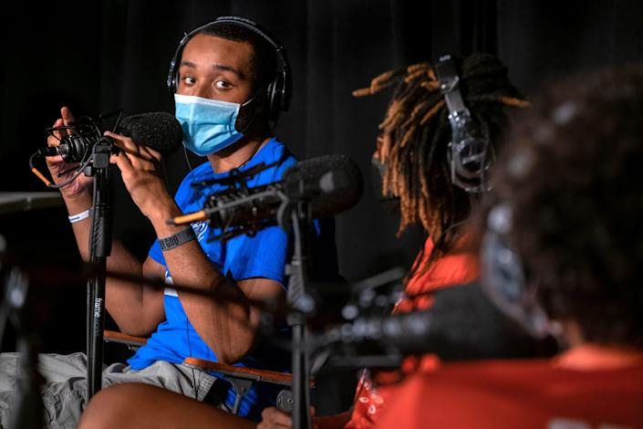 """Branden Lewis, left, discusses gun violence while recording an episode of the podcast """"Stitchcast Studio"""" at the Grandel Theatre in St. Louis on Aug. 13."""