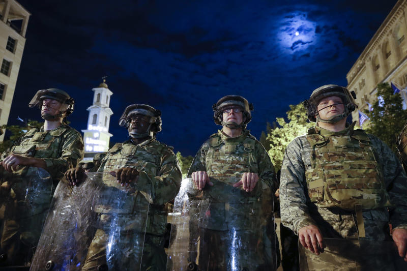 Utah National Guard soldiers stand on a police line as demonstrators gather to protest the death of George Floyd, Thursday, June 4, 2020, near the White House in Washington. Floyd died after being restrained by Minneapolis police officers. (AP Photo/Alex Brandon)