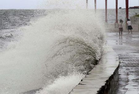 Big waves crash at the coast due to strong winds brought by Typhoon Goni, locally named as Ineng, at the Manila bay in Navotas city, north of Manila August 20, 2015. REUTERS/Romeo Ranoco