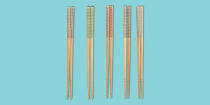 """<p>Chopsticks are quite a multi-purpose tool. Not only can they be used to eat your favorite Asian food or <a href=""""https://www.goodhousekeeping.com/food-recipes/g35950955/easy-asian-recipes/?"""" rel=""""nofollow noopener"""" target=""""_blank"""" data-ylk=""""slk:Asian-inspired recipe"""" class=""""link rapid-noclick-resp"""">Asian-inspired recipe</a>, like <a href=""""https://www.goodhousekeeping.com/food-recipes/a38391/basil-chile-chicken-stir-fry-recipe/"""" rel=""""nofollow noopener"""" target=""""_blank"""" data-ylk=""""slk:basil chicken chile stir-fry"""" class=""""link rapid-noclick-resp"""">basil chicken chile stir-fry</a>, but also they can be used to flip bacon in a pan, make Japanese <a href=""""https://www.goodhousekeeping.com/food-recipes/easy/g428/easy-egg-recipes/"""" rel=""""nofollow noopener"""" target=""""_blank"""" data-ylk=""""slk:egg recipes"""" class=""""link rapid-noclick-resp"""">egg recipes</a> or can even be used for eating snacks to keep your fingers crumb-free.</p><p>Disposable wooden chopsticks work, but they're technically designed for one-time use and can get deformed pretty quickly, splinter or grow mold. Whether you're looking to upgrade from those throwaway chopsticks or need a pair to cook with, it's important to find the right chopsticks that best suit your needs and preferences. They come in a variety of shapes, sizes and materials, and there are even pairs designed to help learn how to properly use them. <br><br>Here in the <a href=""""https://www.goodhousekeeping.com/institute/about-the-institute/a19748212/good-housekeeping-institute-product-reviews/"""" rel=""""nofollow noopener"""" target=""""_blank"""" data-ylk=""""slk:Good Housekeeping Institute"""" class=""""link rapid-noclick-resp"""">Good Housekeeping Institute</a> Kitchen Appliances and Technology Lab, we are constantly testing <a href=""""https://www.goodhousekeeping.com/appliances/a34429387/best-small-kitchen-appliances/"""" rel=""""nofollow noopener"""" target=""""_blank"""" data-ylk=""""slk:kitchen appliances"""" class=""""link rapid-noclick-resp"""">kitchen appliances</a> and <a href=""""https://www.goodhousek"""