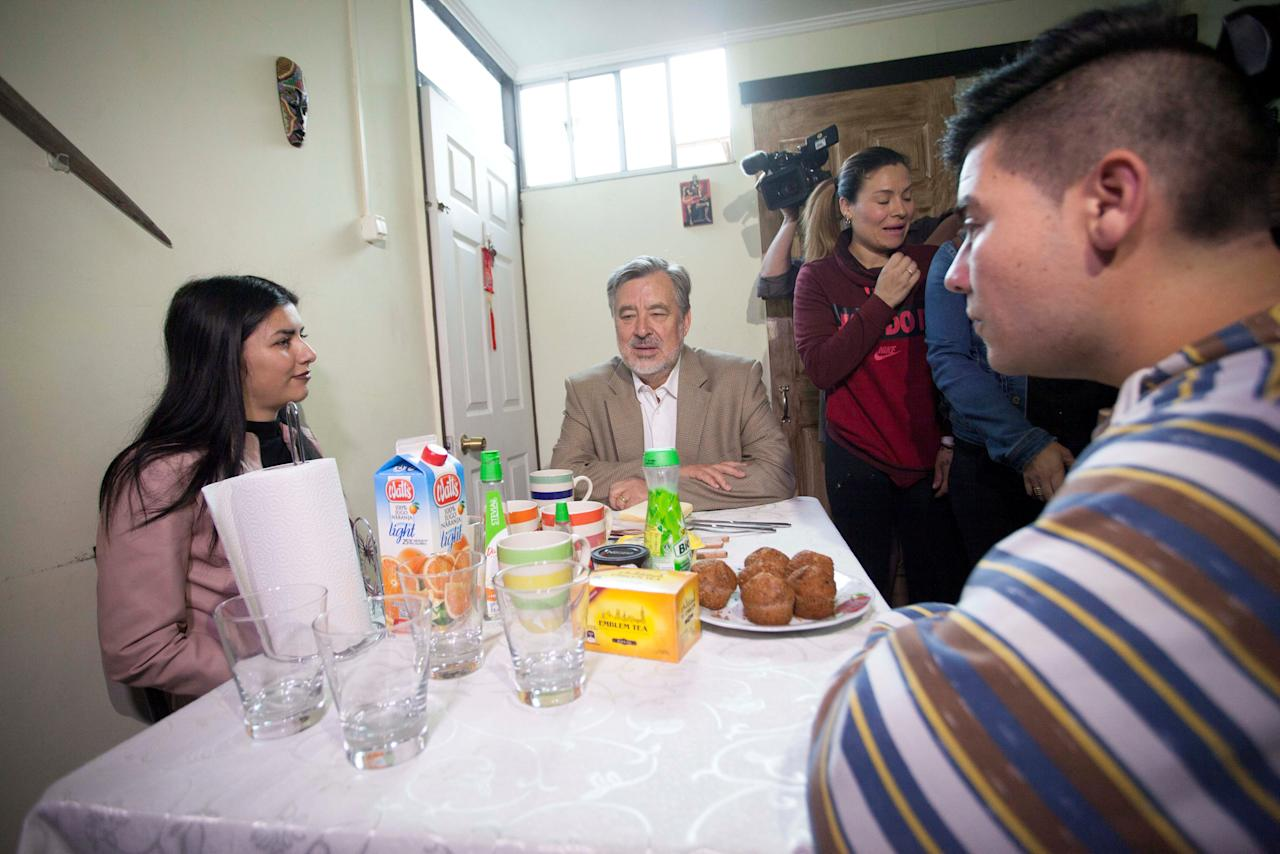 Chilean presidential candidate Alejandro Guillier has breakfast with family before going to cast his vote during the presidential election in Antofagasta, Chile, November 19, 2017. Jose Francisco Zuniga/Courtesy of presidential command of Alejandro Guillier/Handout via Reuters ATTENTION EDITORS - THIS IMAGE WAS PROVIDED BY A THIRD PARTY.