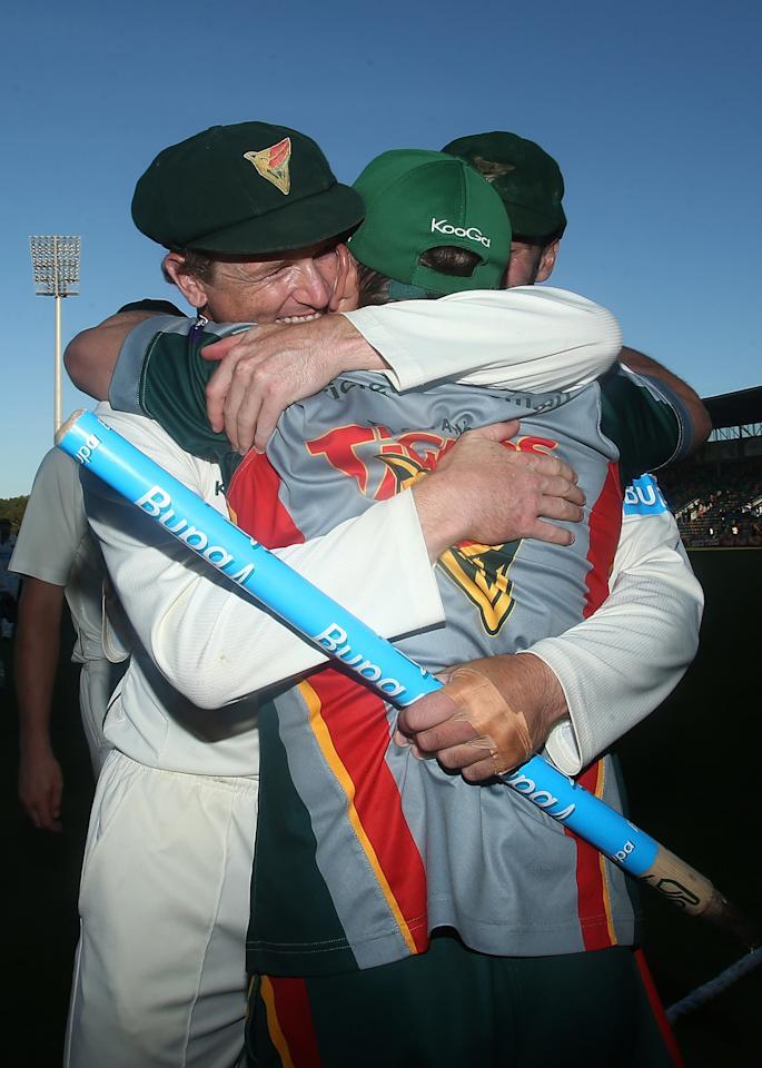 HOBART, AUSTRALIA - MARCH 26:  George Bailey of the Tigers embraces coach Tim Coyle after victory in the Sheffield Shield final between the Tasmania Tigers and the Queensland Bulls at Blundstone Arena on March 26, 2013 in Hobart, Australia.  (Photo by Mark Metcalfe/Getty Images)