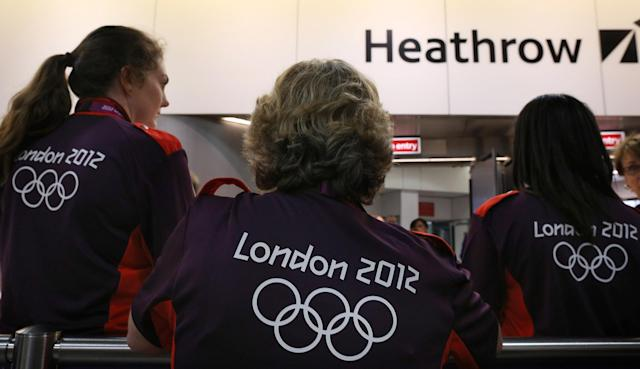 Olympic volunteers wait to greet arriving teams at Heathrow Airport on July 16, 2012 in London, England. Athletes, coaches and Olympic officials are beginning to arrive in London ahead of the Olympics. (Photo by Peter Macdiarmid/Getty Images)