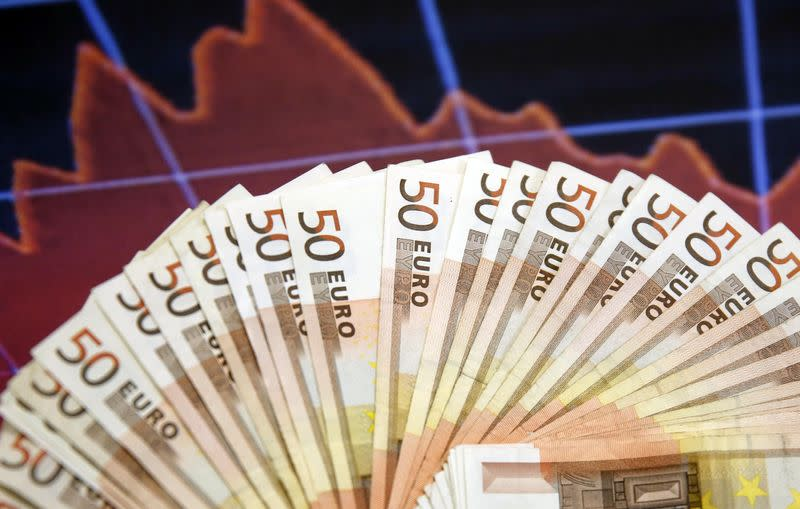 A picture illustration shows Euro banknotes in front of a stocks graph in Sarajevo