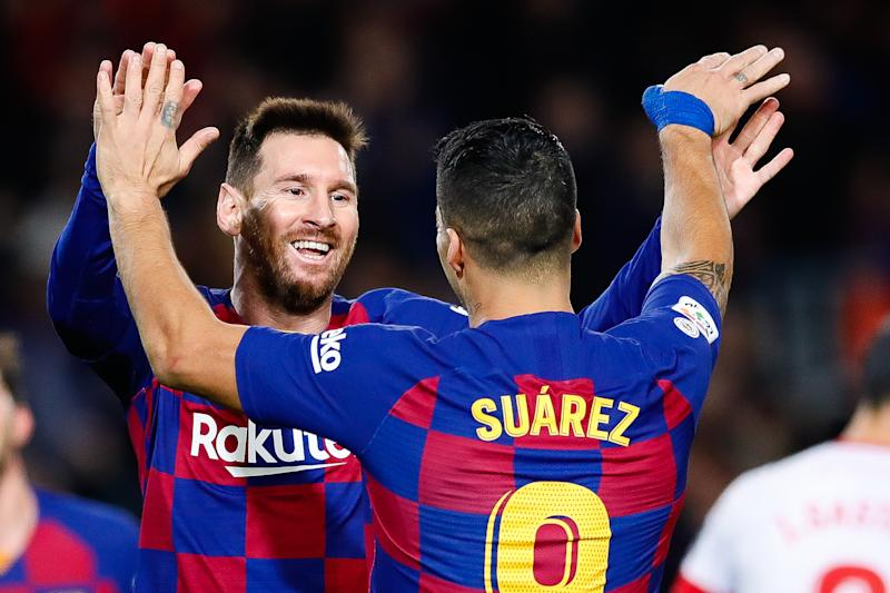 Lionel Messi celebrates with Luis Suarez during a 2019 match.