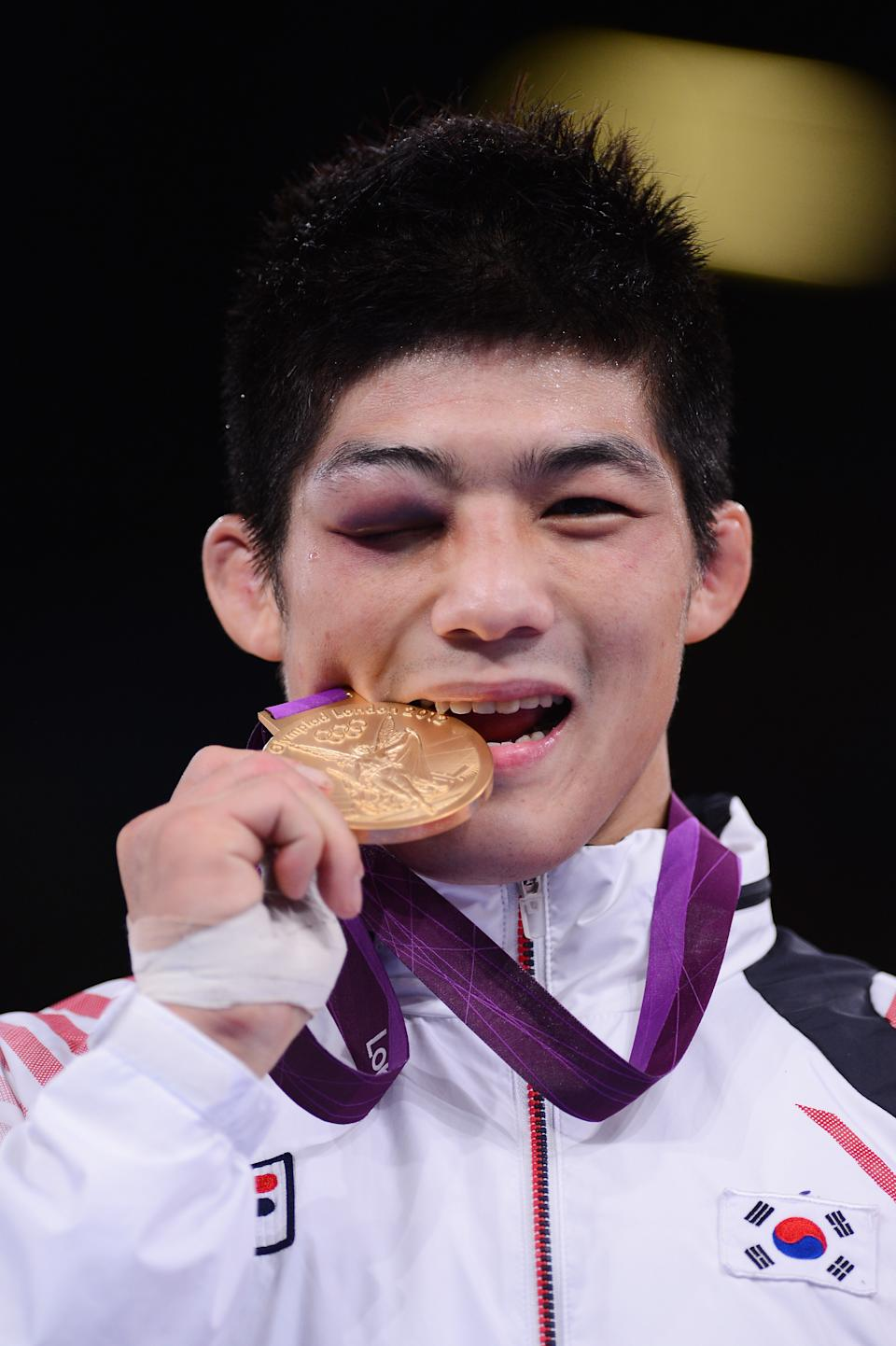 LONDON, ENGLAND - AUGUST 07: Gold medalist Hyeonwoo Kim of Korea in the Men's 66kg Greco-Roman Quarter-Final on Day 11 of the London 2012 Olympic Games at ExCeL on August 7, 2012 in London, England. (Photo by Mike Hewitt/Getty Images)