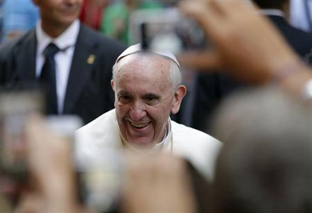 Pope Francis smiles as he arrives for a private visit at the Saint Agostino church in Rome
