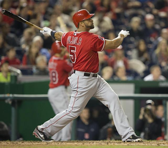 Los Angeles Angels Albert Pujols watches the ball after connecting for a two-run homer against Washington Nationals Taylor Jordan in the fifth inning of a baseball game in Washington, Tuesday, April 22, 2014. This was Pujols 500th career home run. (AP Photo/Pablo Martinez Monsivais)