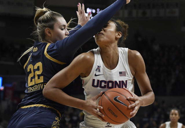 Notre Dame's Danielle Cosgrove, left, fouls Connecticut's Olivia Nelson-Ododa in the second half of an NCAA college basketball game, Sunday, Dec. 8, 2019, in Storrs, Conn. (AP Photo/Jessica Hill)