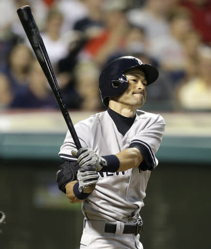 New York Yankees' Ichiro Suzuki reacts after striking out swinging against Cleveland Indians relief pitcher Scott Atchison in the eighth inning of a baseball game Wednesday, July 9, 2014, in Cleveland. (AP Photo/Tony Dejak)