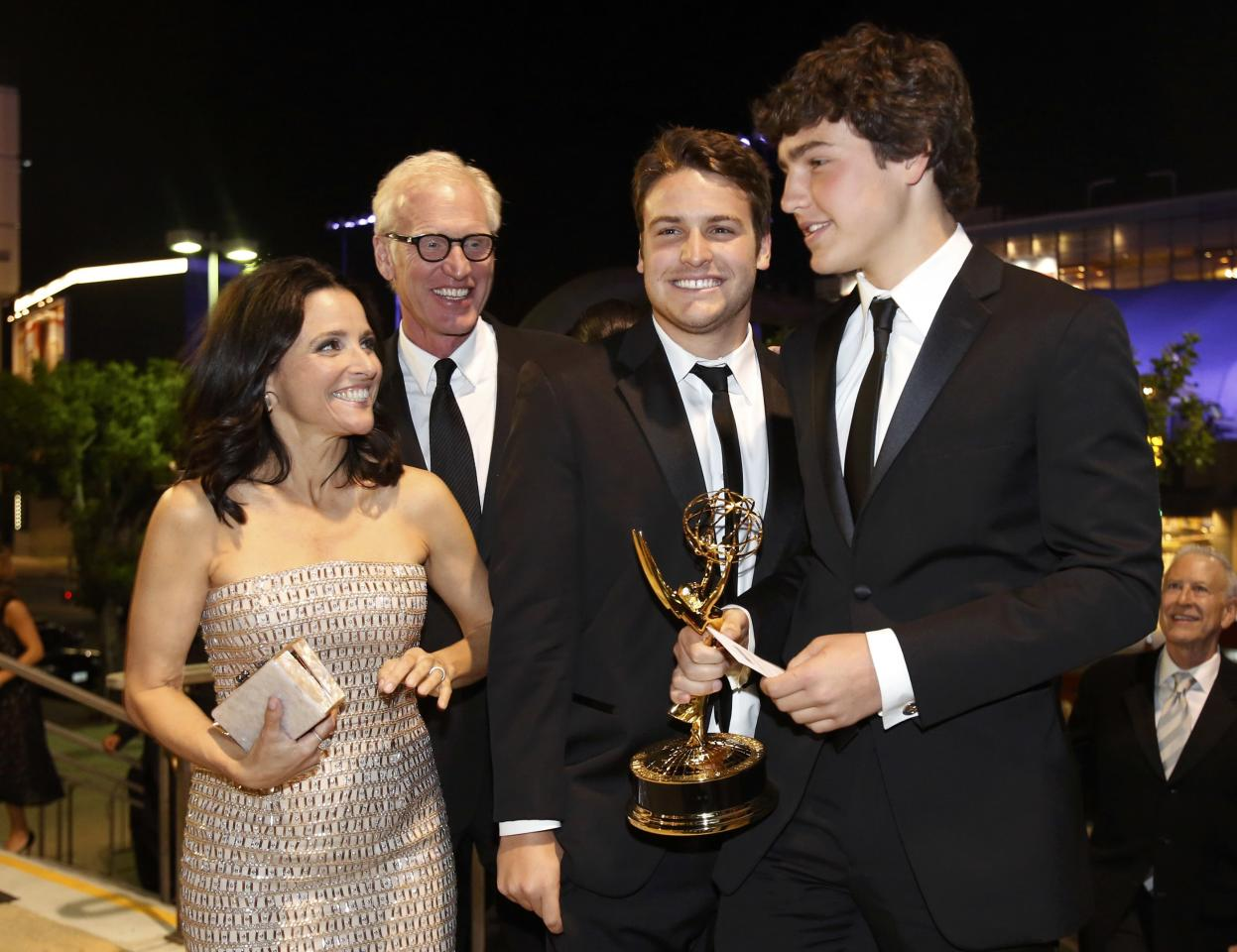 Actress Julia Louis-Dreyfus, with her husband, Brad Hall, and children Henry Hall (C) and Charlie Hall, arrive at the Governors Ball for the 65th Primetime Emmy Awards in Los Angeles September 22, 2013. REUTERS/Mario Anzuoni (UNITED STATES - Tags: ENTERTAINMENT) (EMMYS-BALL)