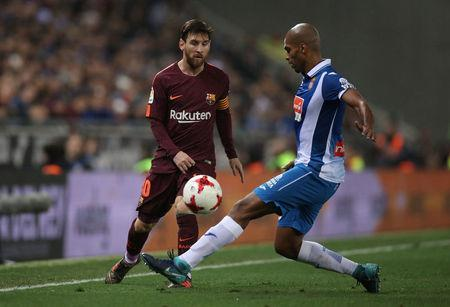 Soccer Football - Spanish King's Cup - Espanyol vs FC Barcelona - Quarter-Final - First Leg - RCDE Stadium, Barcelona, Spain - January 17, 2018 Barcelona's Lionel Messi in action with Espanyol's Naldo REUTERS/Albert Gea